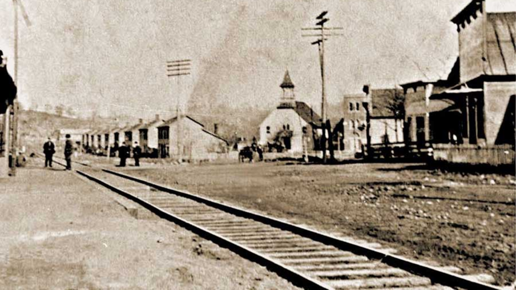 Hungarian Row in Buchtel,  Parish of St. Patrick is now St. Mary of the Hills. Where the railroad is pictured, is now modern-day State Route 78.